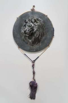 A meiji period Japanese bronze roundel of a roaring tiger.