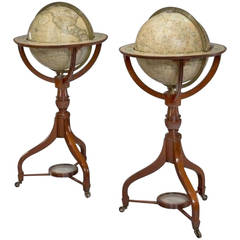 A fine pair of matched 12 inch floor standing globes by Cary