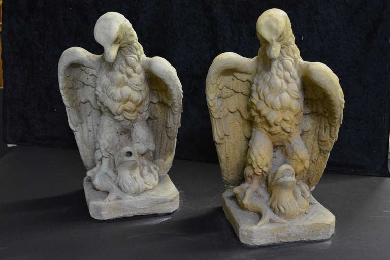 A pair of garden eagles, one cast stone has piping for a fountain, the other cast sandstone is a statue. Priced each. Nicely detailed for your garden delight!  Provenance-From the Harkness Estate Garden The Harkness Family, America's Society