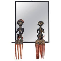 Unique Steel Frame Mirror with Figural African Comb Mounts