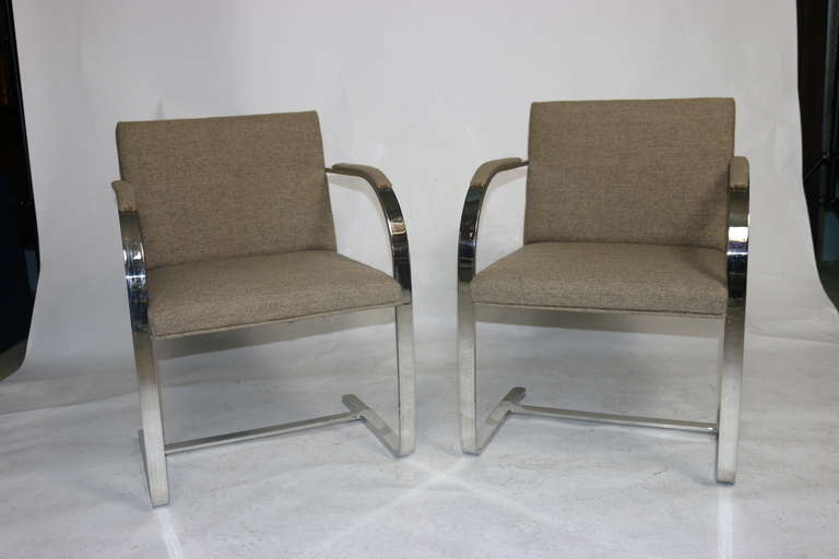 """Classically designed Brueton pair of """"Brno"""" armchairs, designed by Ludwig Mies van der Rohe, polished flat stainless steel frames upholstered in a handsome Harris wool tweed over padded seats and backs with a padded armrest for comfort. Made by one"""