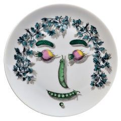A Piero Fornasetti Arcimboldesca-Motif Vegetable Face Plate