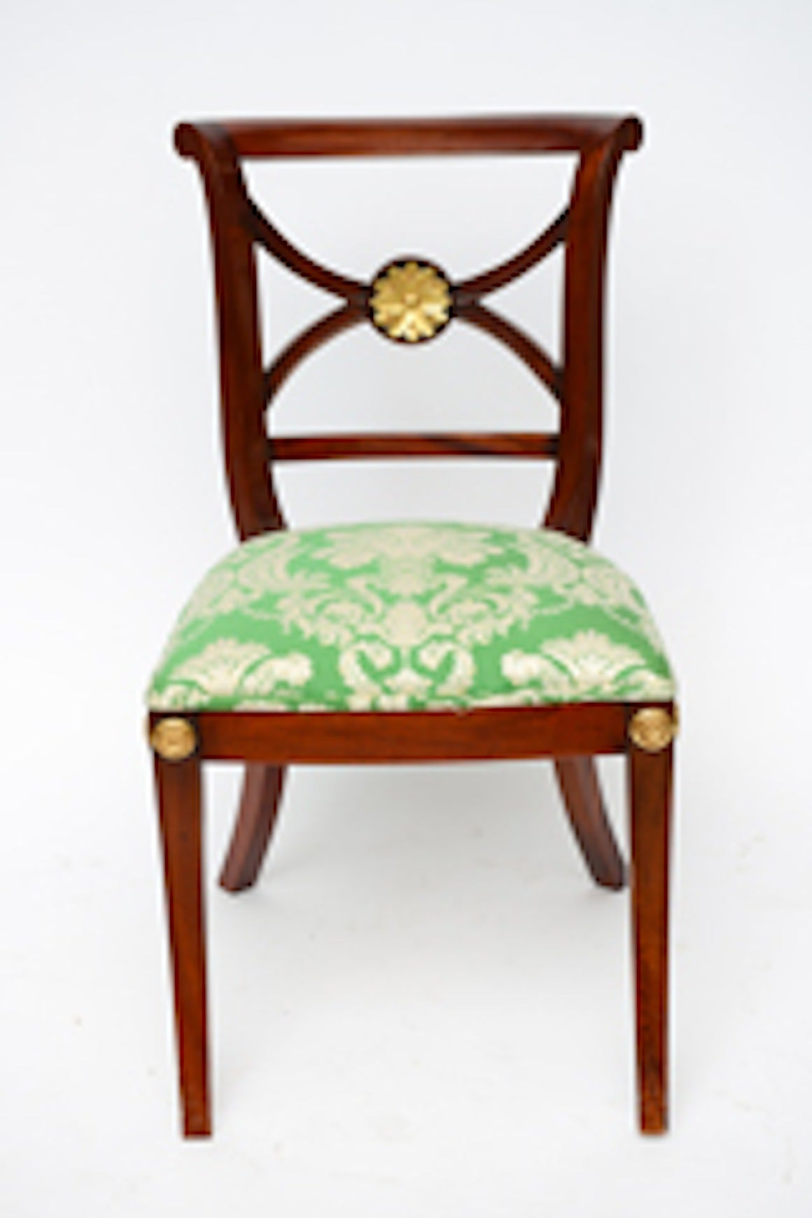 Mahogany Elegant Regency Klismos Dining Chairs, Highly Carved Gilt Details, 19th Century For Sale
