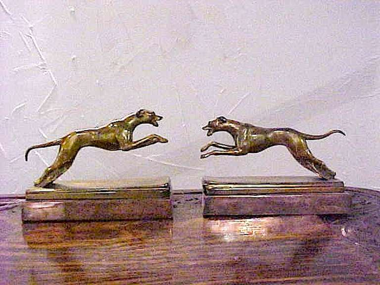 An Art Deco superb pair of highly detailed bronze running action greyhound bookends on a polished copper base. Great for your bookshelf, desk or console.