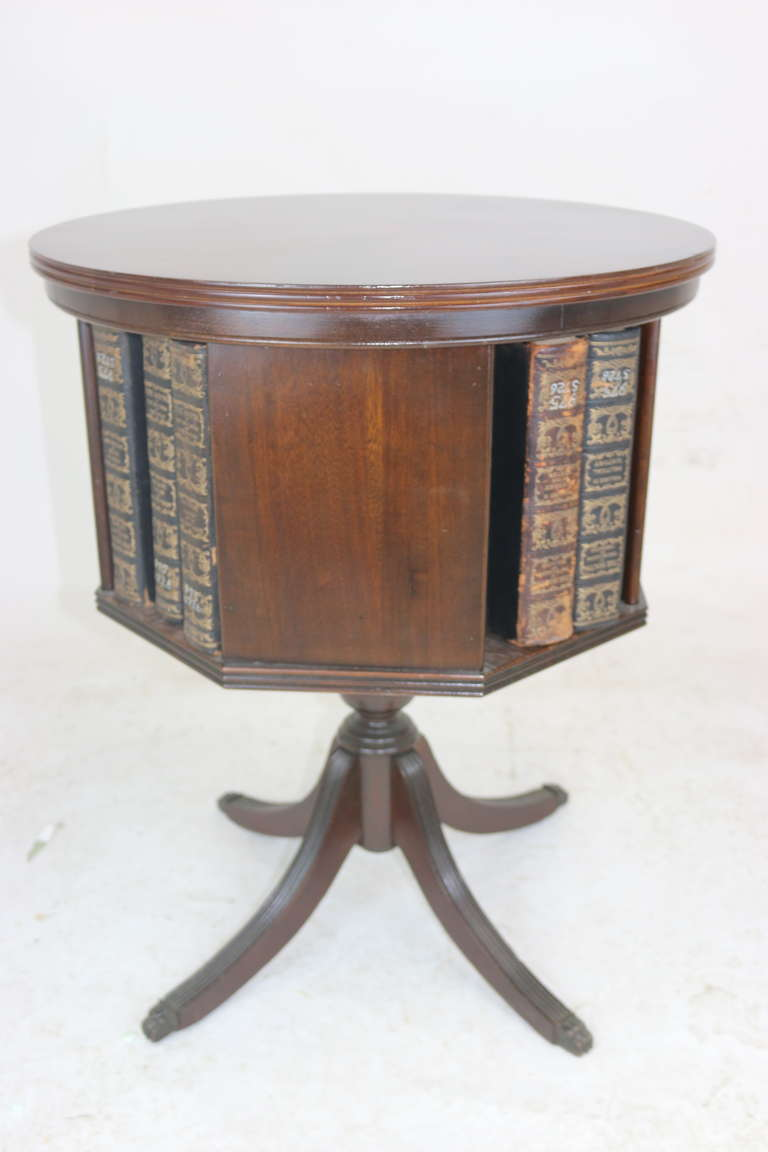 A Federal Style Drum Table With Revolving Bookshelf Four Solid Panels And Openings For Books
