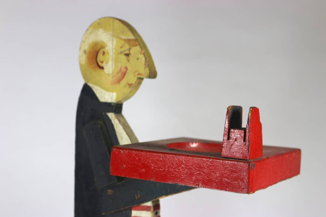 1930s Butler Smoking Stand with Original Paint holding a Wood Tray with a matchbox holder attached--vivid colors, Nicely painted Face--Great Aura. Can be a candy or food tray or business card holder, candles, etc. etc. One of the many