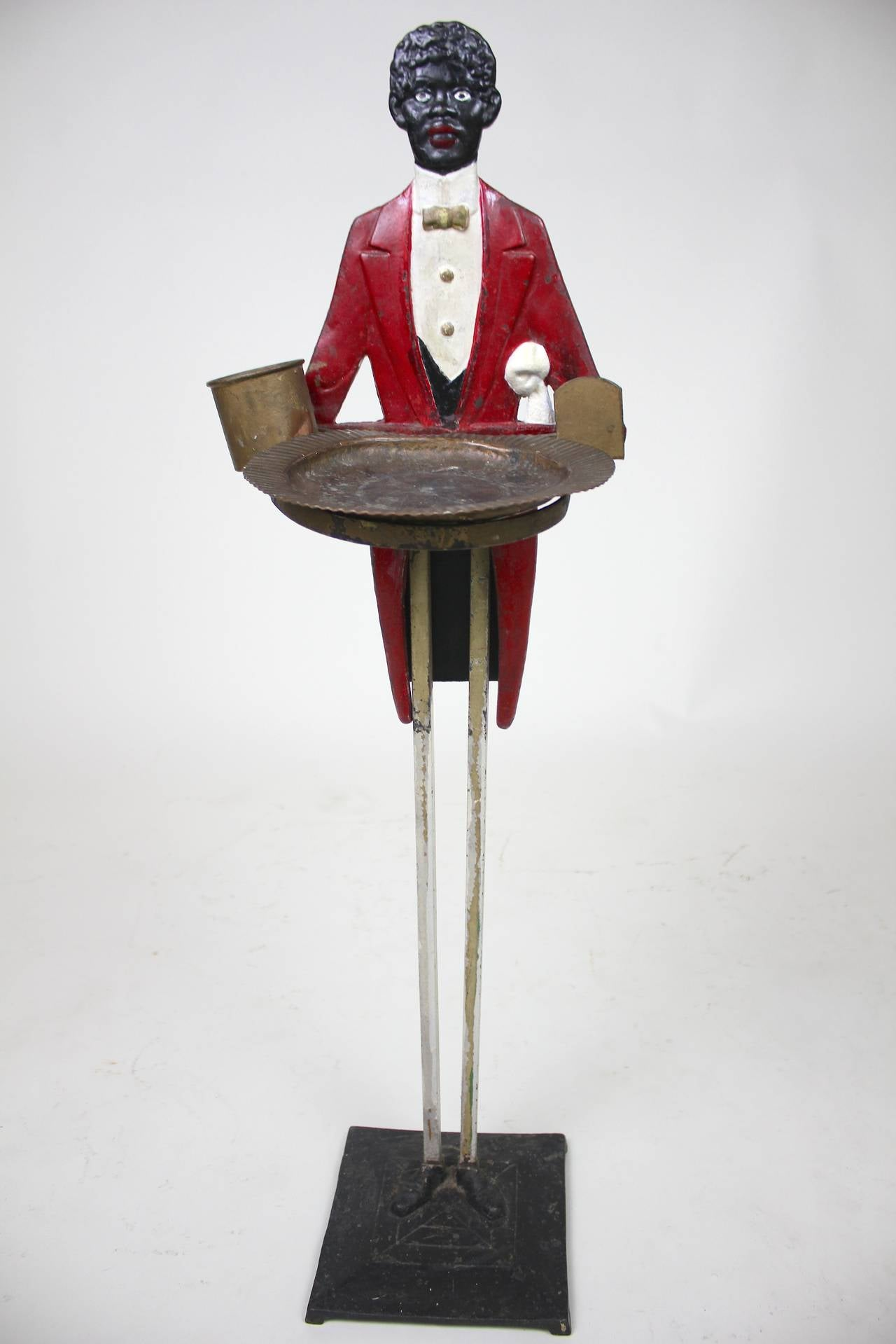 An American Folk Art Butler smoking stand for cigarettes, matches holding an ash tray, can also be used as an umbrella or cane stand(without the tray) or for serving hors d'oeuvres or candy, cards, etc. An original butler stand with a copper holder