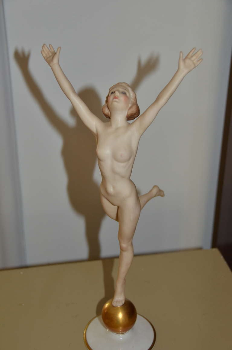 Art Deco bisque female nude standing on a metallic gold ball in a lovely Art Deco 1920s pose by Hutschenreuther, the German china factory in Selb. Beautiful facial expression and very fine details-hands, feet, face, hair, body. Stamped under the