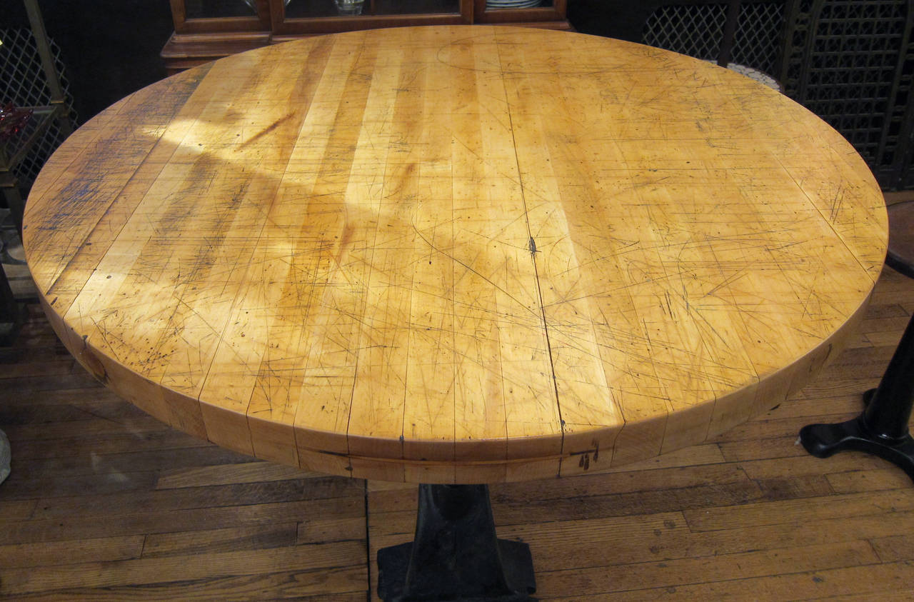 refurbished round butcher block table with heavy cast iron base 2