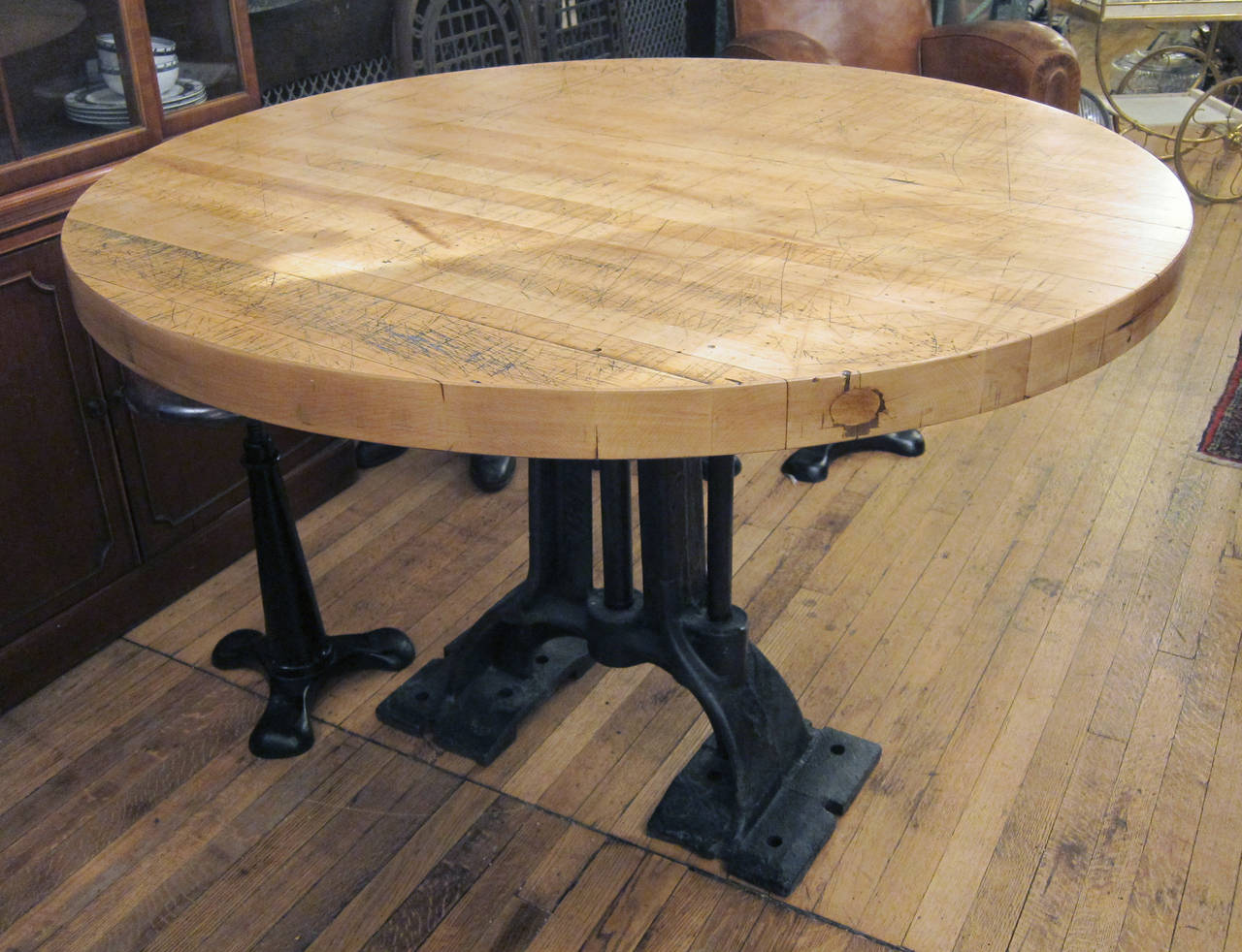 refurbished round butcher block table with heavy cast iron