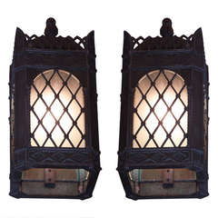 1929 Pair of Bronze Tudor Style Sconces with Frosted Glass