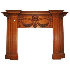 1800s English Regency Style Carved Oak Tall Mantel with Lion, Ribbon and Swags
