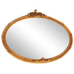 Early 1900s Ornate Oval Gold Framed Mirror with Light Distressing