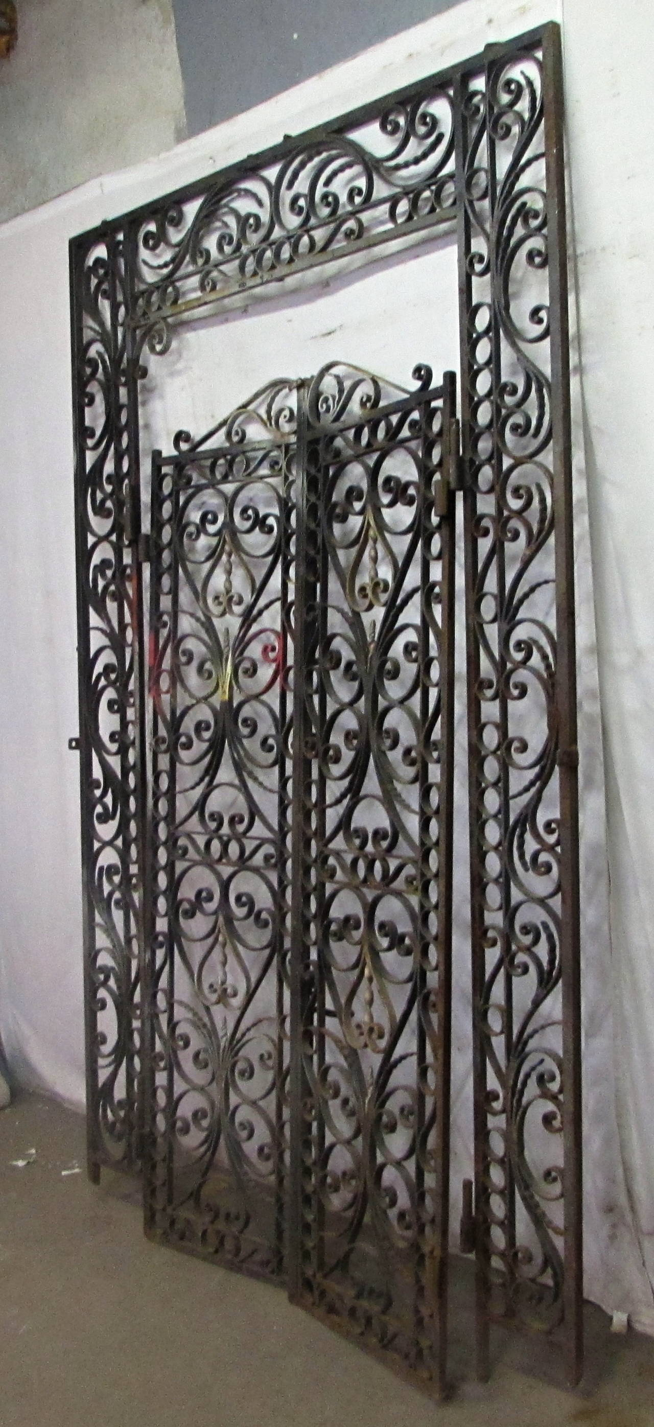 S highly ornate wrought iron entry gates with surround