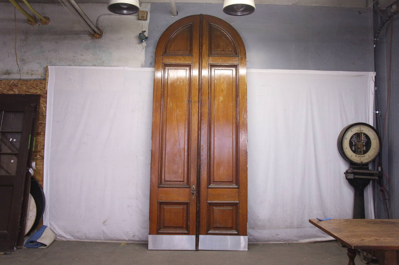 Late 19th Century 1876 Pair of Oversize Raised Panel Arched Entry Double Doors from New Jersey For Sale