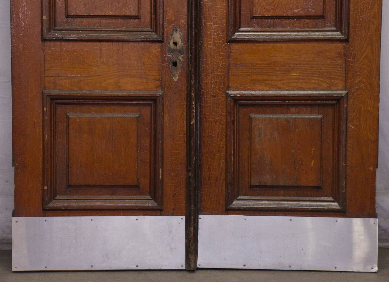 Wood 1876 Pair of Oversize Raised Panel Arched Entry Double Doors from New Jersey For Sale