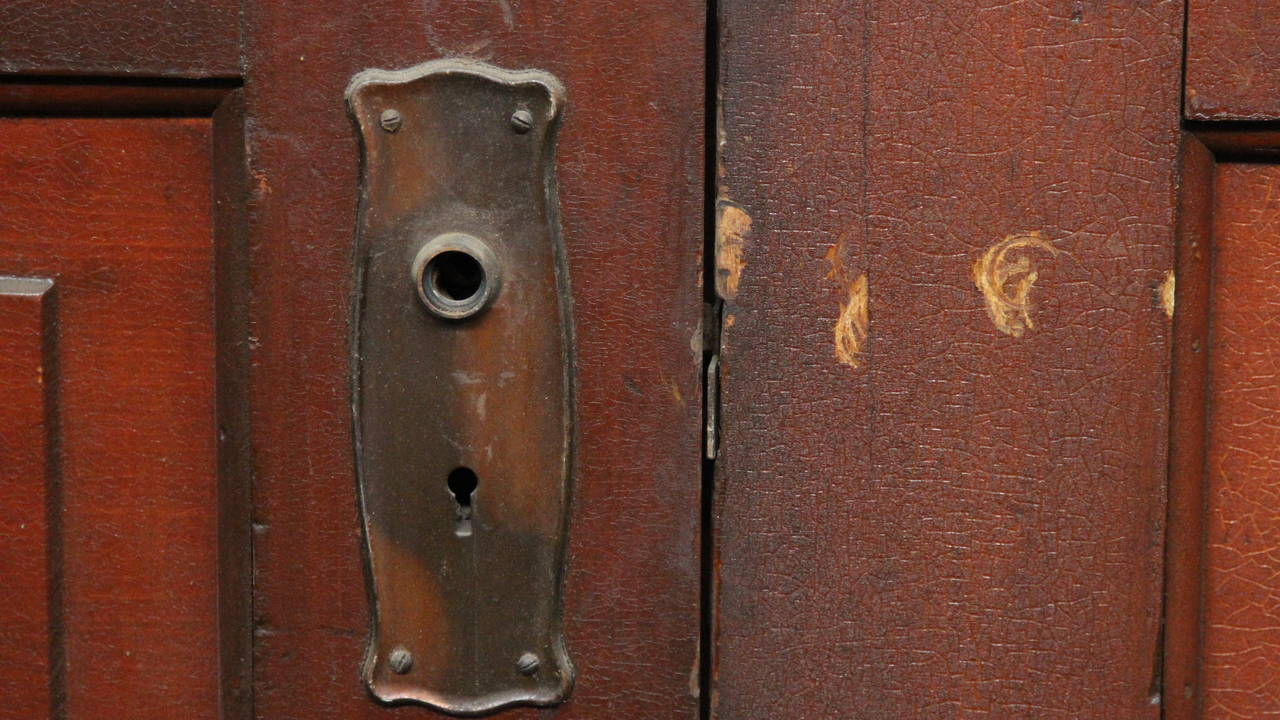 Early 20th Century 1920s Pair of Five-Panel Wooden Doors with Original Fumed Copper Hardware For Sale