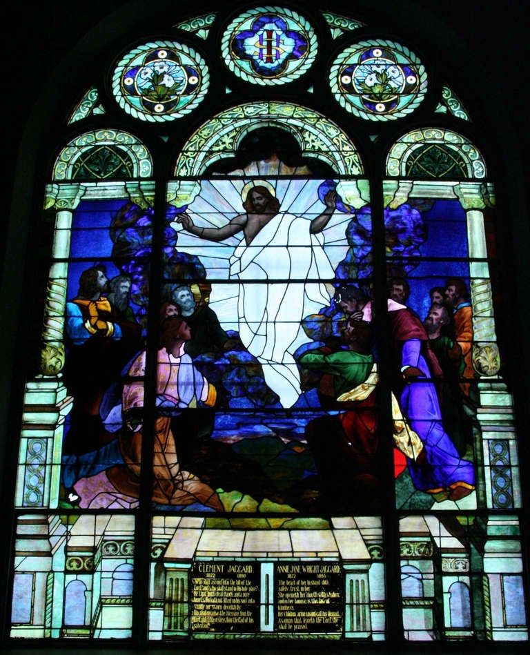 Here is a beautiful stained glass window depicting the Ascension of our Lord Jesus surrounded by His apostles. This is a huge window measuring approximately 19.5 ft. high and 13 ft. wide. It is in good condition and has brilliant colors. From 1901.