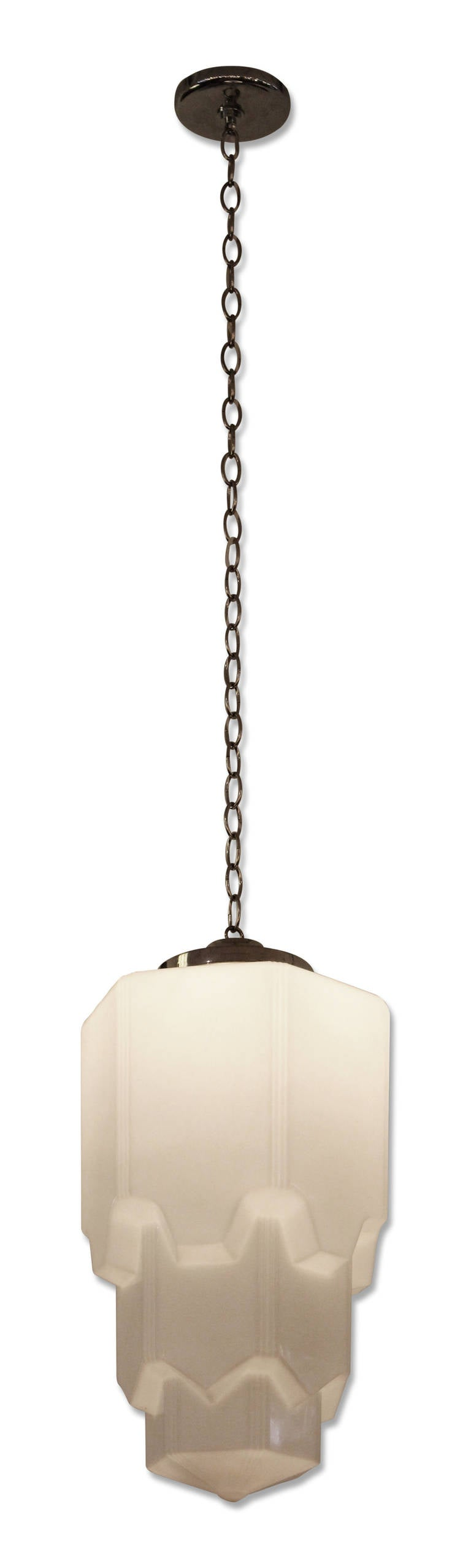 Skyscraper art deco pendant light with a stepped design comes equipped with new