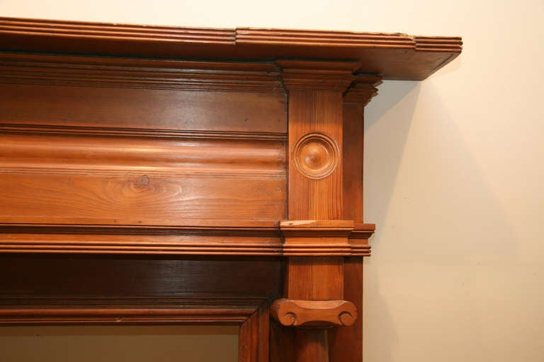 Antique carved wooden federal mantel with bullseye detail
