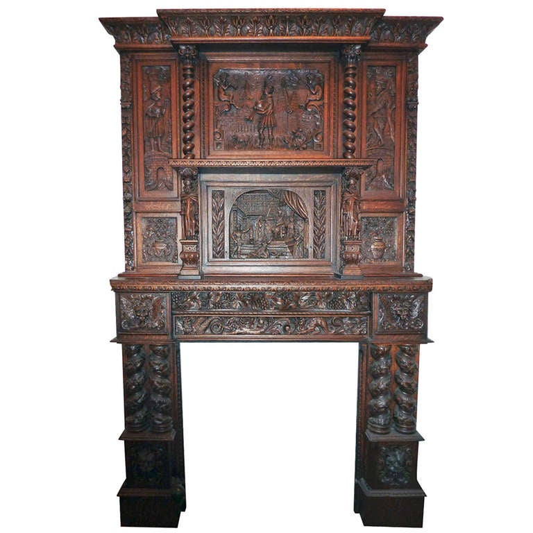 Heavily carved wooden english tudor mantel with figures at for Tudor style fireplace