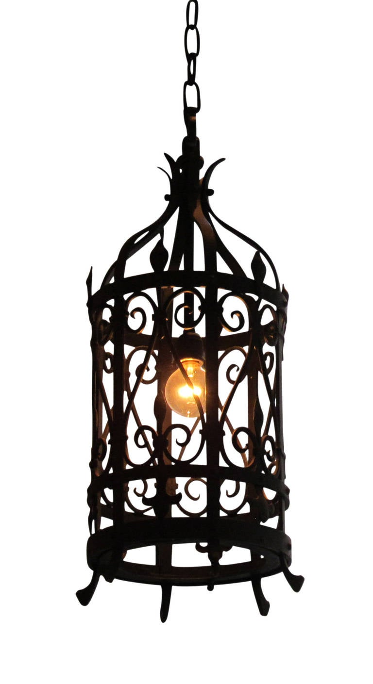 pair of wrought iron lantern light fixtures for sale at 1stdibs. Black Bedroom Furniture Sets. Home Design Ideas