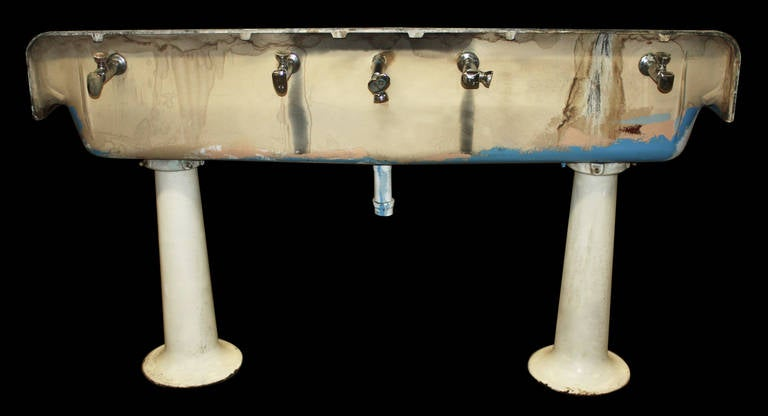Industrial porcelain gang sink on pedestal legs without for Pedestal sink with metal legs