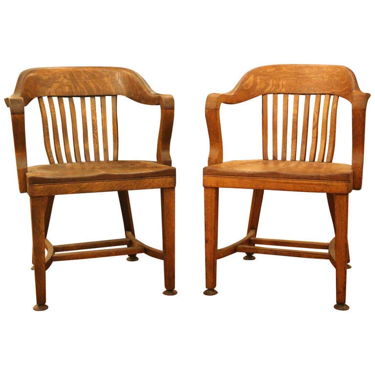 Pair of oak bankers chairs at 1stdibs