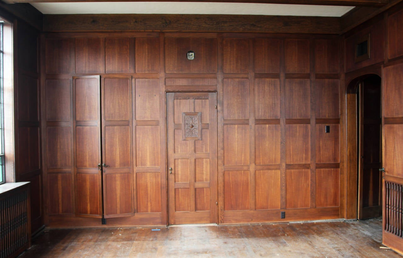 1905 solid english oak paneled room with matching door Ways to update wood paneling