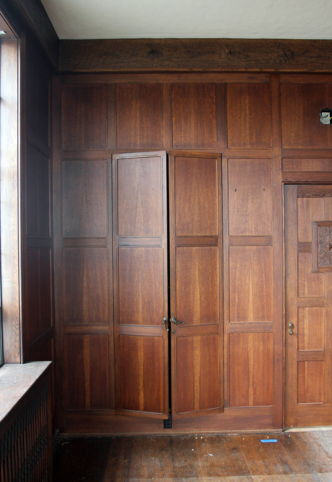 1905 solid english oak paneled room with matching door from two