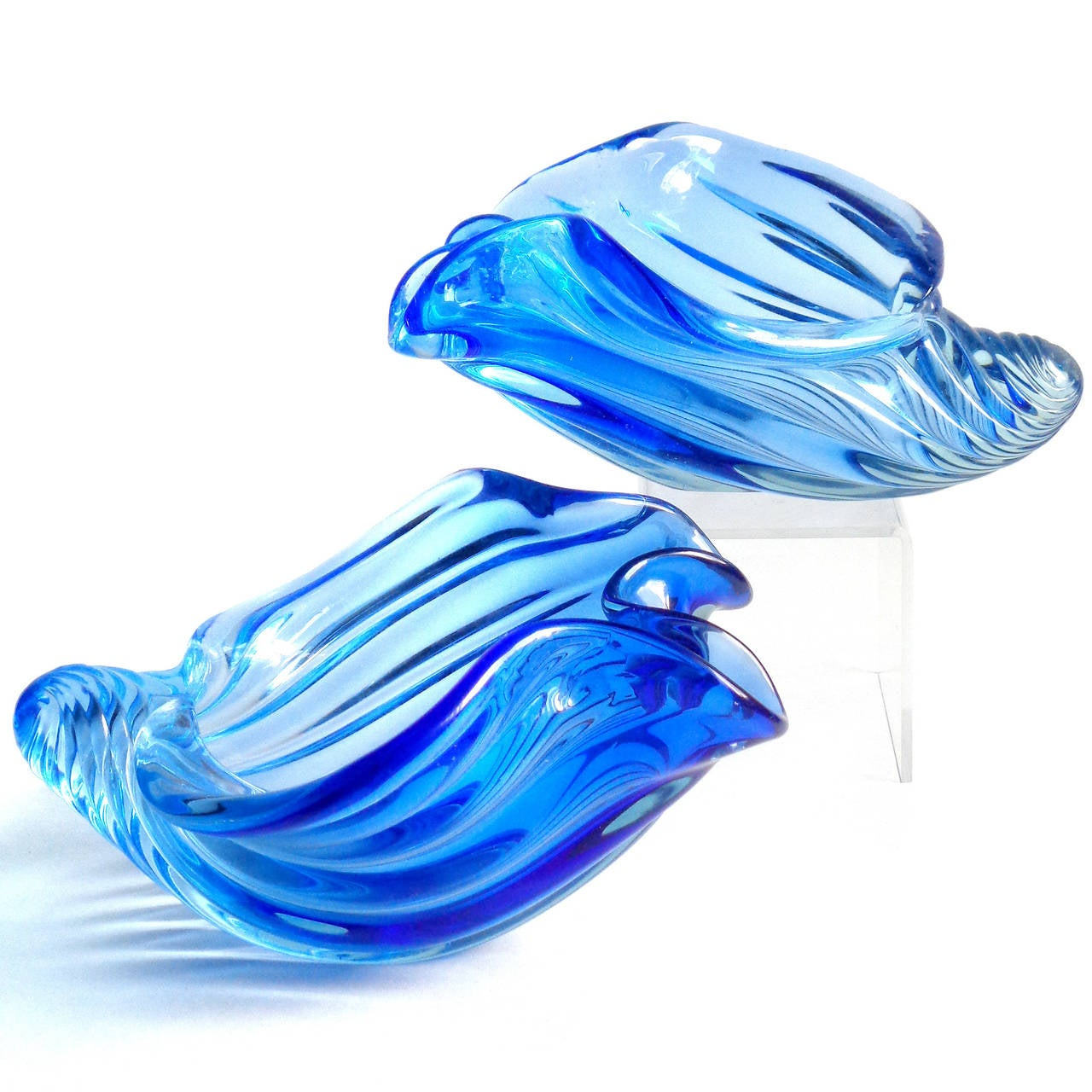 Gorgeous set of two Murano hand blown Sommerso cobalt blue Italian art glass seashell sculptural bowls. Documented to Alfredo Barbini, circa 1950s-1960s. One is a little larger than the other. Perfect for any Marine or Ocean themed room. Similar and