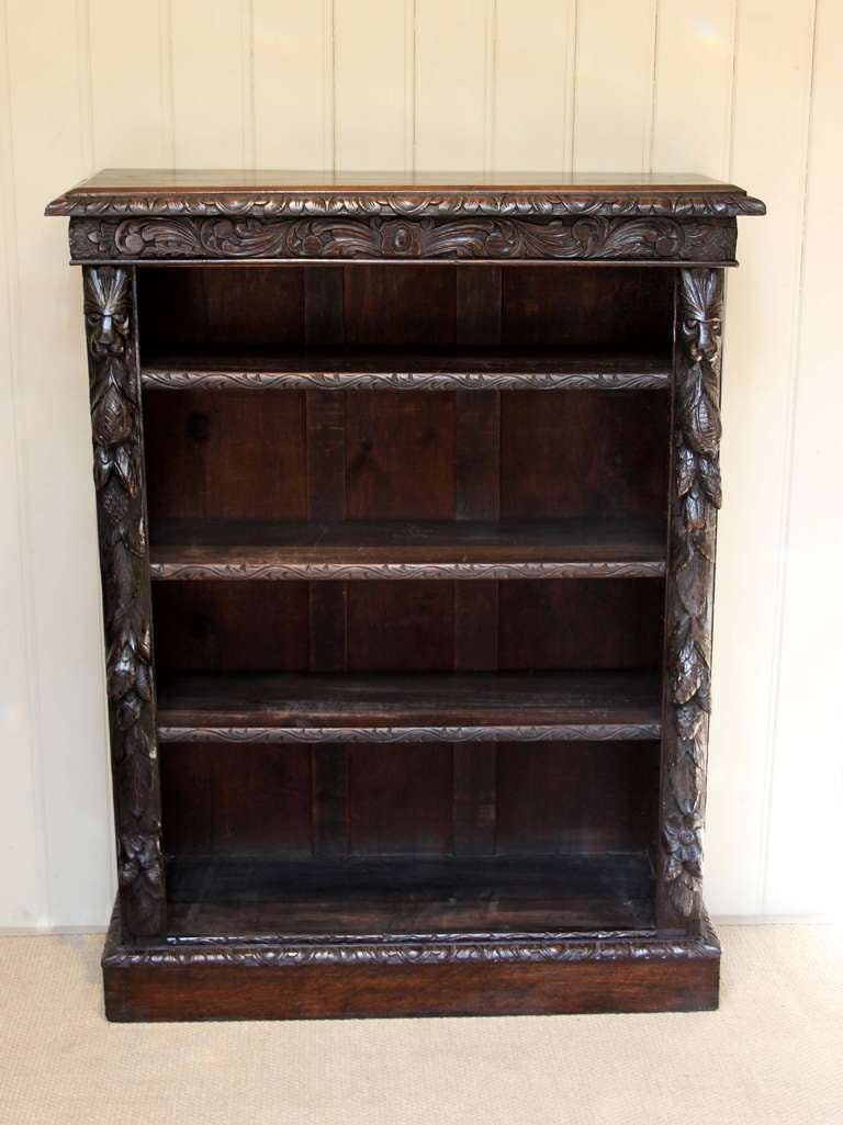 Victorian Dark Oak Open Bookcase Having Three Adjule Shelves In A Hevily Carved Gothic Style