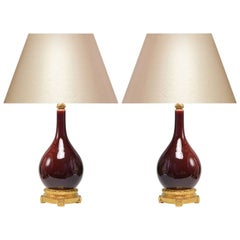 Pair of Copper Red-Glazed Porcelain Lamps with Gilt Bronze Bases