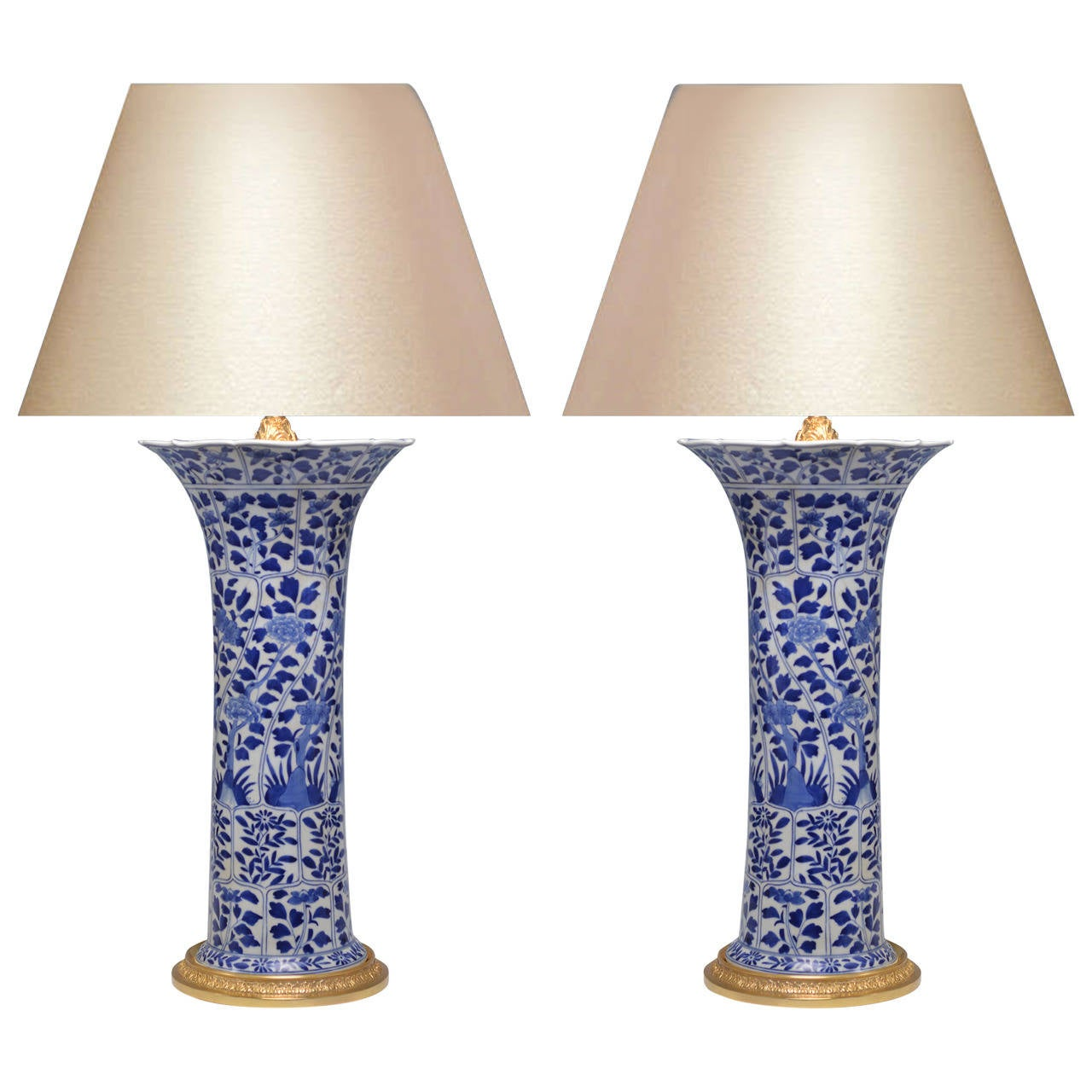 pair of blue and white porcelain lamps with gilt brass bases 1