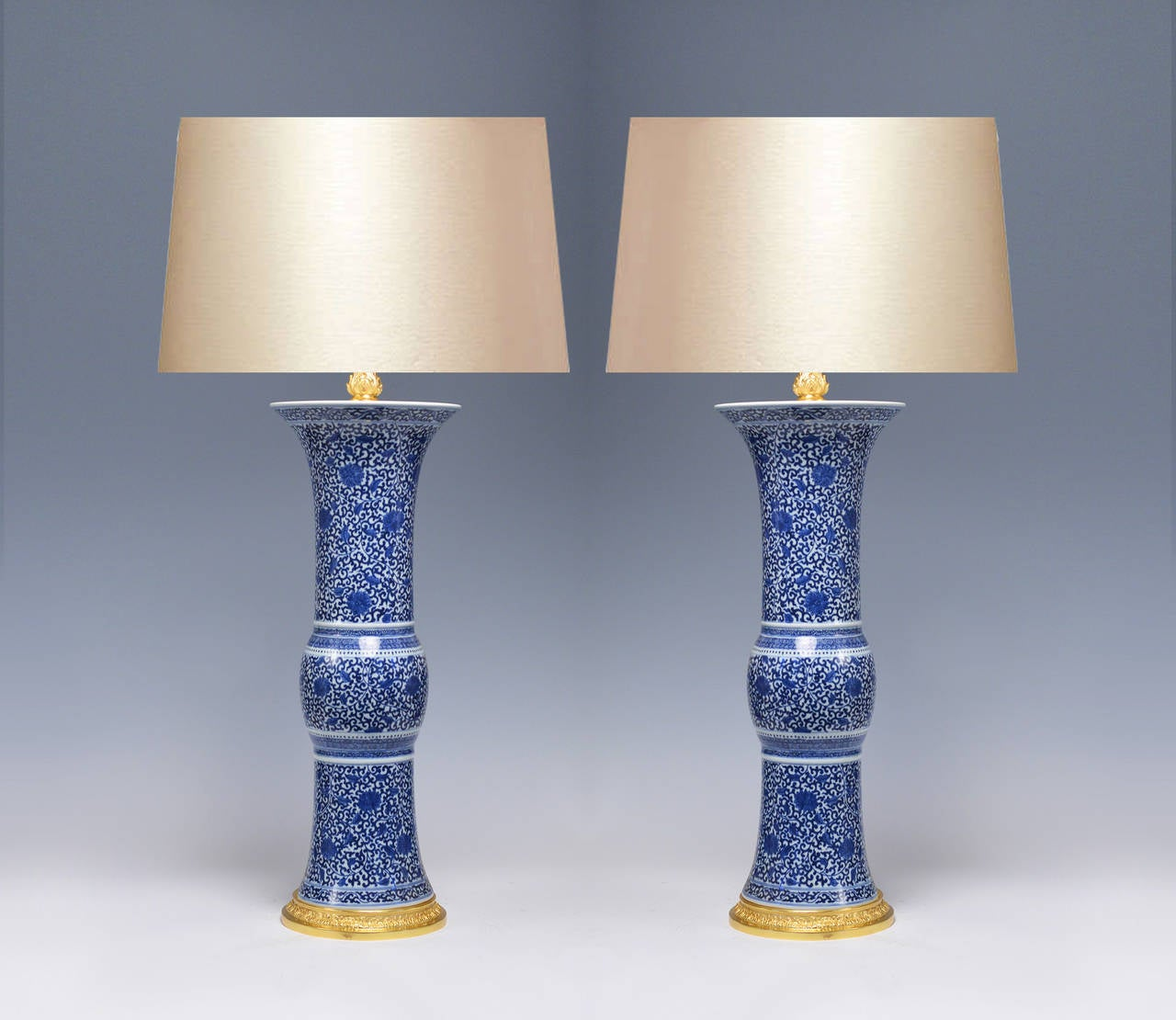 Pair of fine painted beaker form blue and white porcelain lamps with floral scroll decoration, 21 1/4