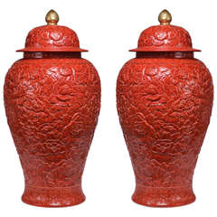Pair of Fine Carved Red Glazed Porcelain Jars with Covers