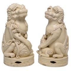 A Pair Of Blac-de-chine Porcelain Foo Lions