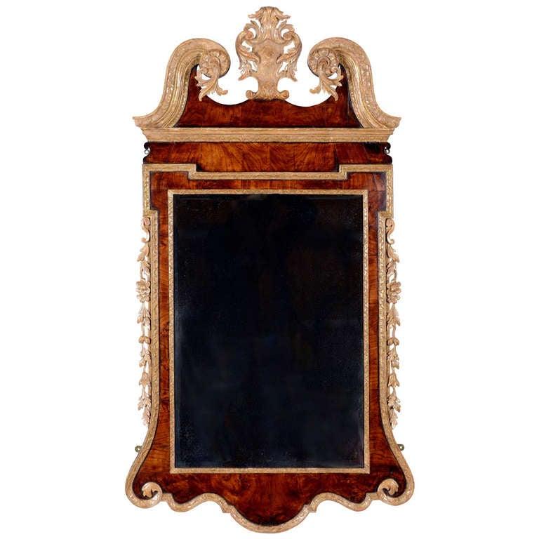George II Figured Walnut and Carved Giltwood Mirror