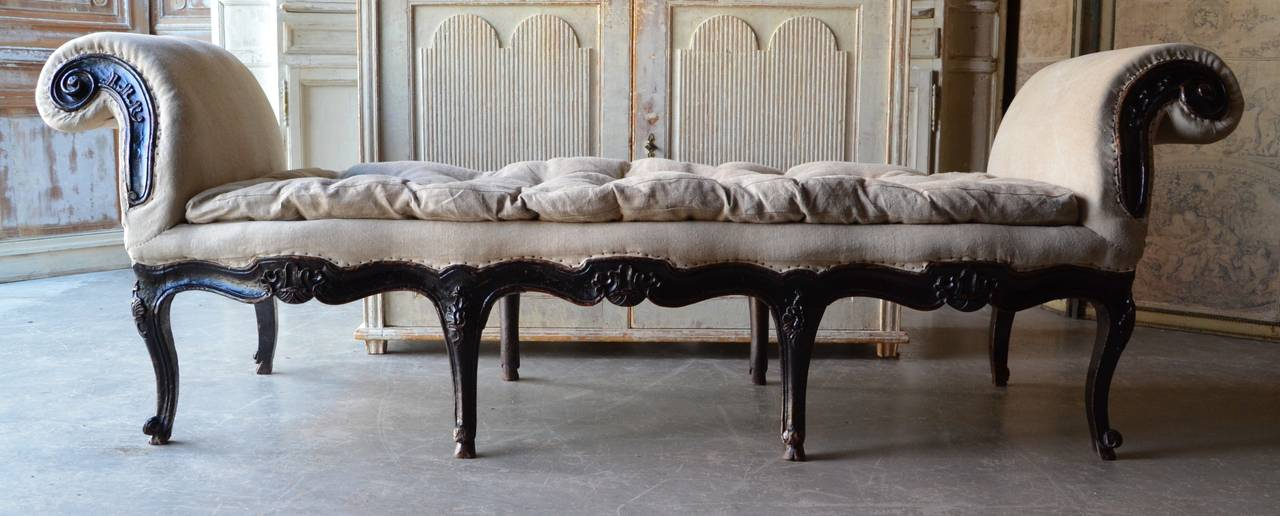18th century Italian Venetian carved walnut divan upholstered in antique linen.