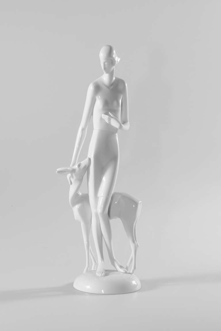 Art Deco porcelain figure of a girl with deer. Design by Gerhard Schliepstein (Germany 1886-1963), 1928. Made by Rosenthal, Selb in 1931. White porcelain, glazed. Marked on the base: Schliepstein. At the bottom green maker's mark and model number