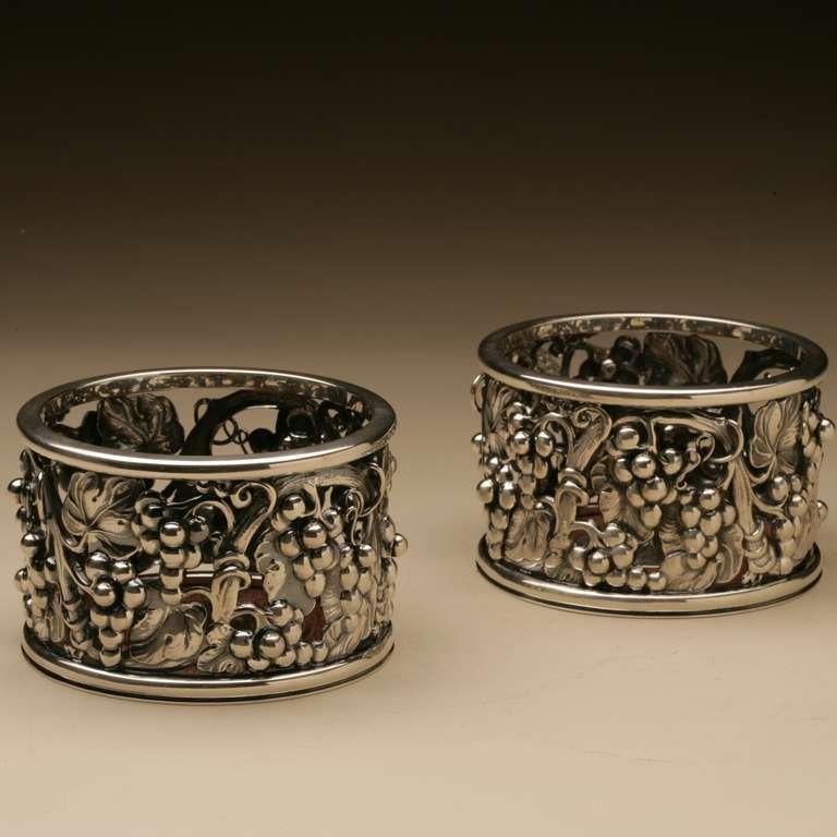 Pair of Evald Nielsen sterling silver wine coasters. Grape vine motif with wooden base. Very heavy. Each measures 4.25