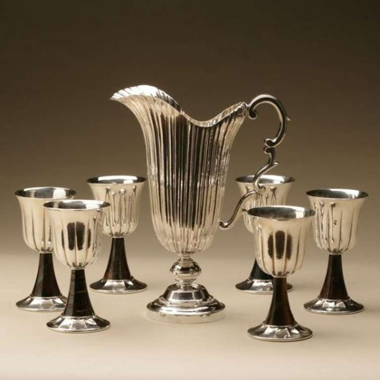 Exceptional handmade detail. Six hand-hammered goblets in total with assorted hard stone stems. Goblets 5.5