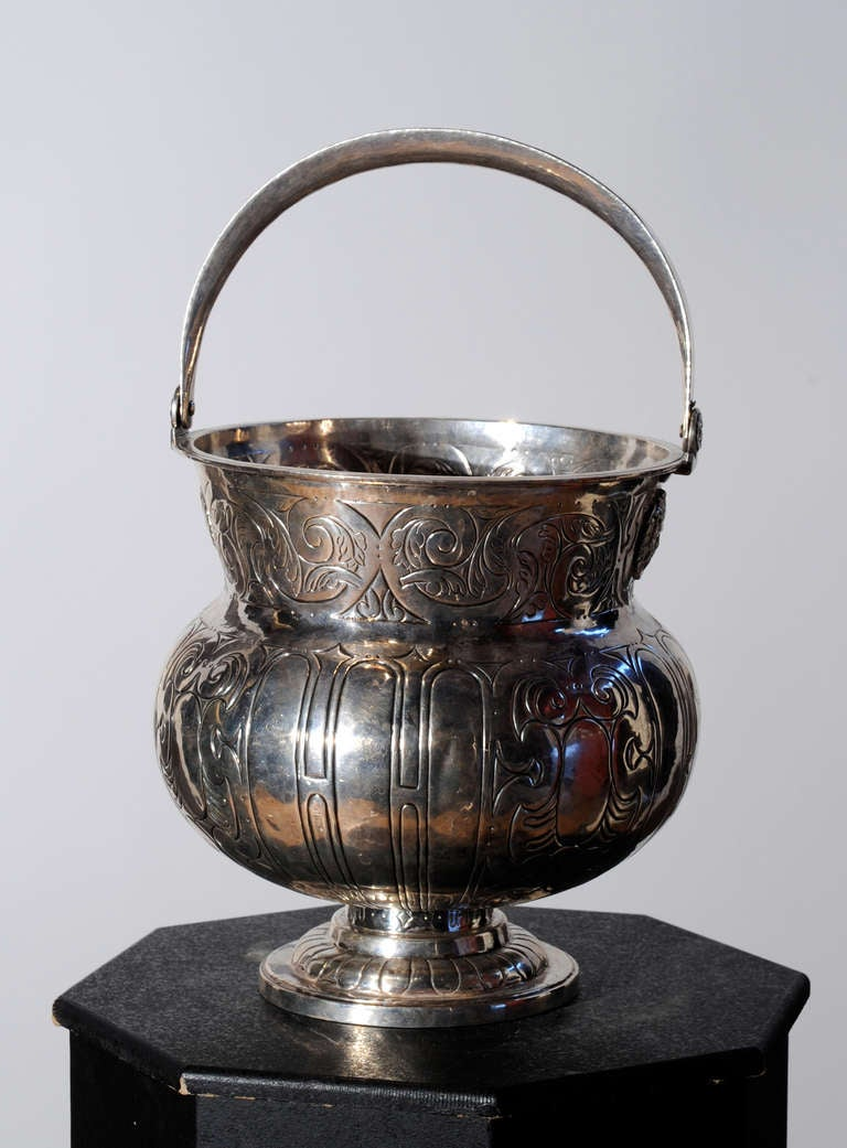 Mainly used in Roman Catholic churches, the aspersorium served as a basin that held, and, from which holy water was dispensed.  This beautiful sterling silver example comes from Seville in South Western Spain in Andalusia.  The silversmith's mark