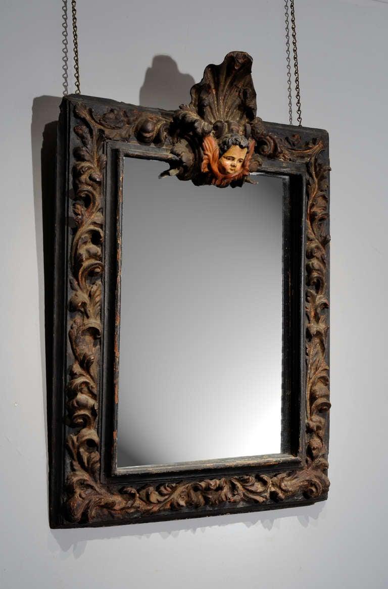 Italian baroque carved mirror surmounted with cherub face for Italian baroque mirror