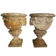 Pair of White Terracotta Urns with Lamb's Head Decoration