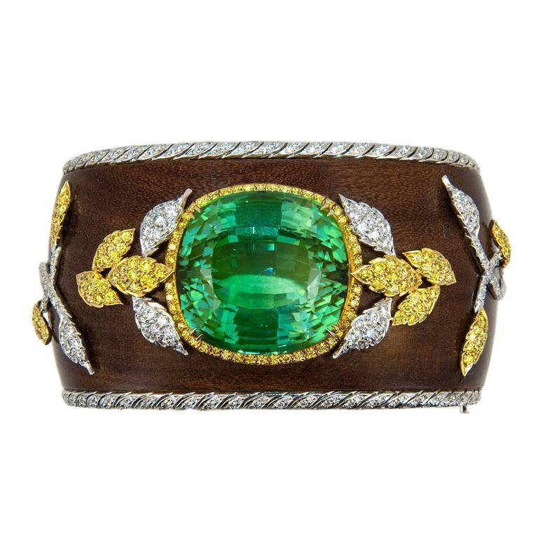 "Artistically designed Fernambuk wood bangle bracelet created to showcase Exquisite Green Tourmaline. 18 karat white and yellow gold bangle bracelet, Fernambuk wood, 1 1/2"" wide with rows of bead and bright set diamonds at edge. Bangle is set"