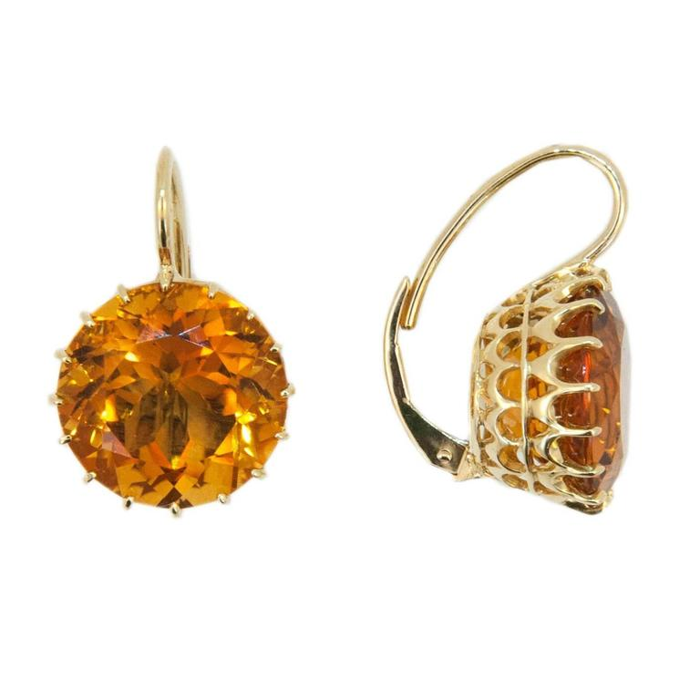 Gorgeous rich Honey colored Citrine earrings on a wire. Stones hand picked by Laura Munder. 18k yellow gold 13.9mm round Honey Citrine multi prong wire earrings. 17.59cts.twt. Pierced leverback.