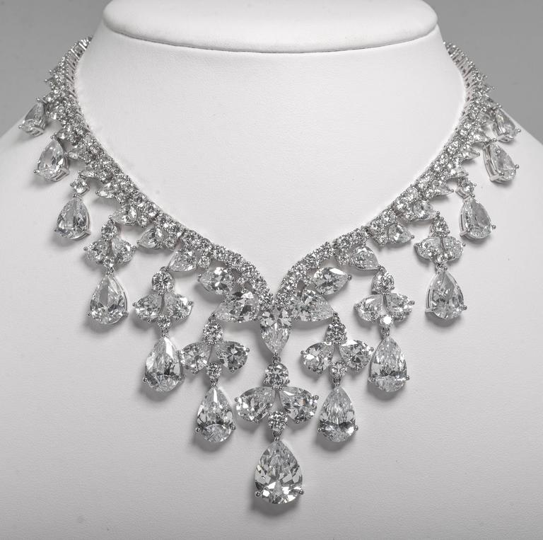 Magnificent cubic zirconia white diamond  fringe collier necklace of amazing elegance and the 'real look'. The necklace is flexible, man made and has amazing sparkle and brilliance. Measures 15 inches neck and the centre drops 2 inches. Comes in a