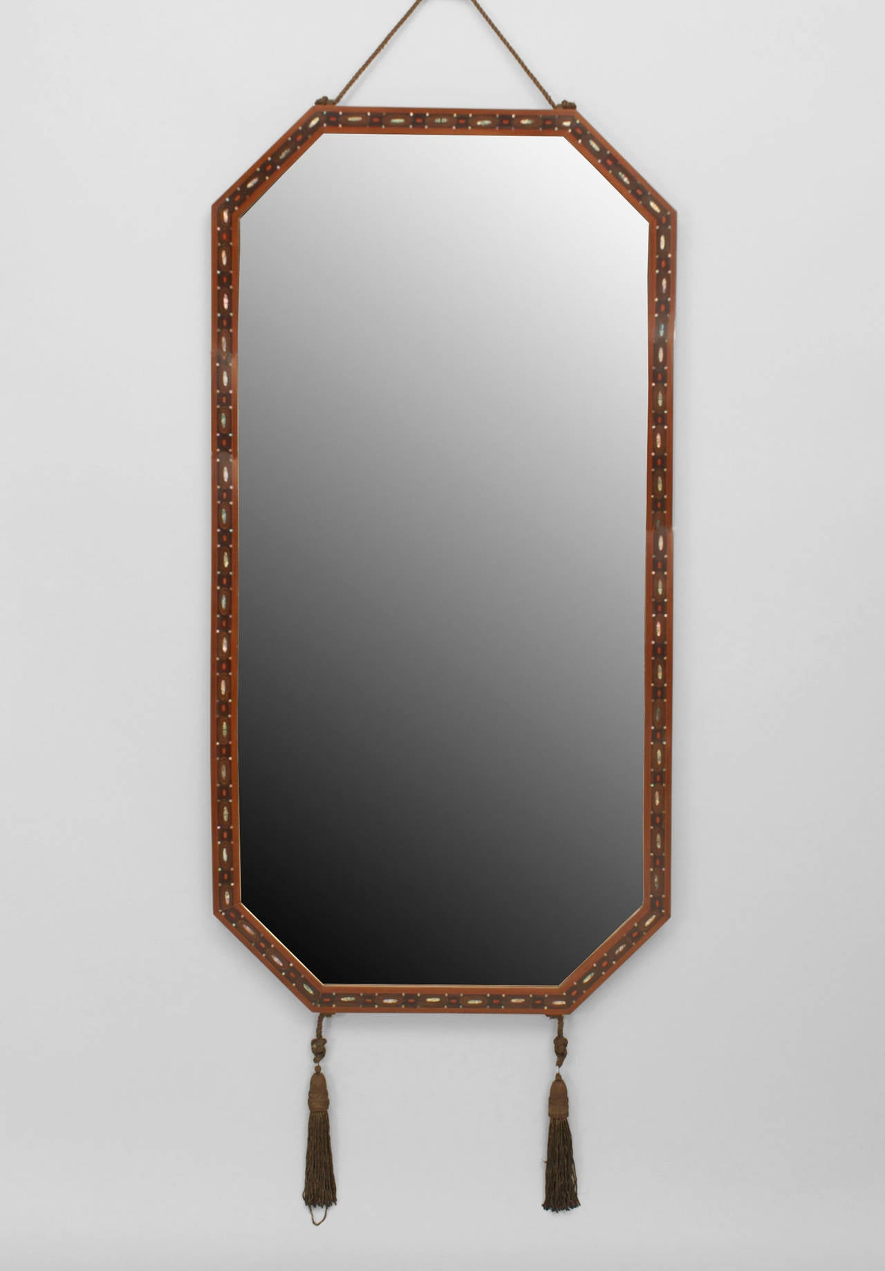 French Art Deco mahogany horizontal 8 sided narrow wall mirror with an inlaid
