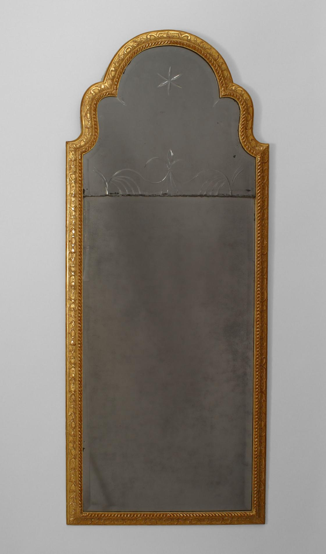 Early eighteenth century English Queen Anne gilt vertical wall mirror with a carved beaded frame with a shaped pediment top with two beveled mirror plates decorated with an etched design.